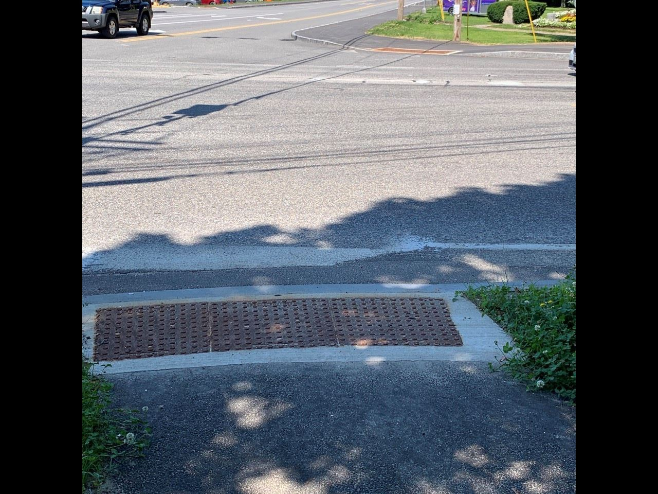 Curb ramp with detectable warning plates at East Ave/Pleasant St/Bartlett St