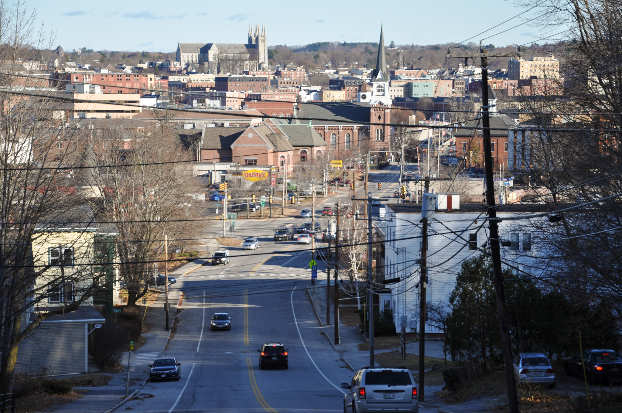 Picture of Court Street in Auburn Maine with the skyline of Lewiston Maine visible in the background